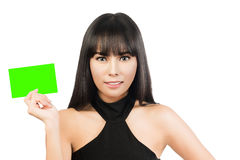 Business card woman. Portrait of a young beautiful businesswoman holding a blank paper sign Stock Images
