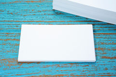 Business card on wood desk Stock Image