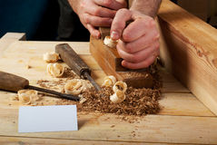 Business card on wooden table for carpenter tools with sawdust. Blank business card on wooden table for carpenter tools with sawdust.Copy space. Top view stock photos