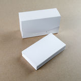 Business cards and a box for them. Blank business cards and a box for them on the table. Template for branding identity Stock Photos
