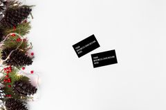 Business cards  christmas composition for branding. fir branches, cones and christmas decorations on white background. Business cards christmas composition for Stock Photos