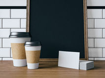 Business cards, coffe cups and black poster. 3d Stock Photography