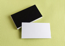 Business cards on a green background Stock Photos