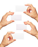 Business cards in hands Stock Photo