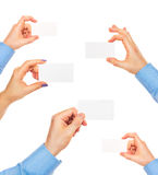 Business cards in hands on white Royalty Free Stock Images