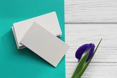 Business cards and iris flower. On wooden background royalty free stock images