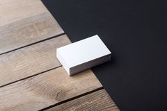 Business cards isolated on old wood background Stock Images