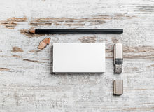 Business cards, pencil, usb flash. Blank stationery set. Business cards, pencil and usb flash drive on vintage wood background. Template for branding identity Stock Image