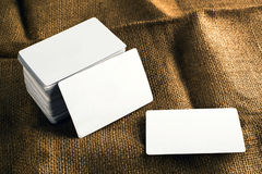 Business cards with rounded corners. Stack of blank horizontal business cards propped up another with copy space for your design. Please, browse my portfolio stock image