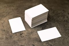 Business cards with rounded corners. Stack of blank horizontal business cards propped up another with copy space for your design. Please, browse my portfolio royalty free stock photos