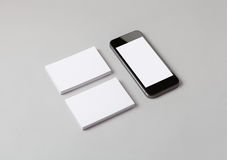 Business cards & smart phone Royalty Free Stock Image