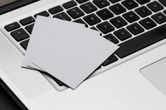 Business cards spread on computer keybaord Royalty Free Stock Image