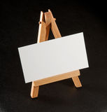 Business cards on a stand. Blank business card on a wooden souvenir stand Stock Photography