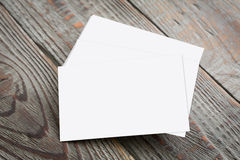 Business cards on wood table Royalty Free Stock Photos