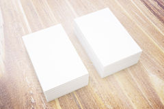 Business cards on wood. Two stacks of blank business cards on wooden surface. Mock up, 3D Rendering stock illustration