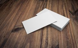 Business cards on wooden table. 3d rendering. Business cards on wooden table stock illustration