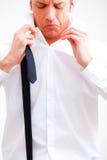 Business career. Businessman tighten cravat to climb up the social ladder and make career Stock Photos