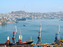 Business cargo russian port Vladivostok. Business cargo russian port against townscape of Vladivostok Royalty Free Stock Images