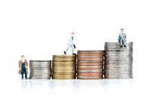 Business cartoon charactor standing on metal coin. Business concept Stock Photo