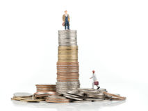 Business cartoon charactor standing on metal coin. Business concept Royalty Free Stock Images