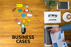 BUSINESS CASES. Businessman working at office desk and using computer and objects, coffee, top view Royalty Free Stock Image