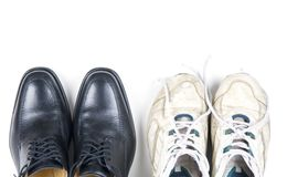 Business casual. Two pairs of shoes � new business shoes and old tennis shoes Stock Photography