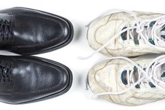 Business casual. Two pairs of shoes ? new business shoes and old tennis shoes Stock Image
