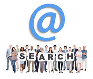 Business And Casual People Holding Word Search. Multi-Ethnic Group Of Business And Casual People Holding Letters That Form Search And Related Symbol Above stock image