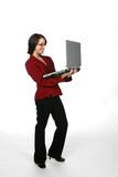 Business casual teen with laptop. Business casual teenage girl holding a laptop Royalty Free Stock Image