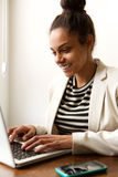 Business casual woman working from home on laptop Royalty Free Stock Images