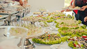 Business catering people take buffet food during company event royalty free stock images