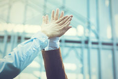Business celebration for good teamwork with a high-five (Vintage Stock Photo