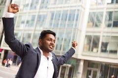 Business celebration. An Indian business man celebrating Stock Photo