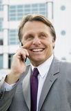 Business on cellphone. Royalty Free Stock Photos