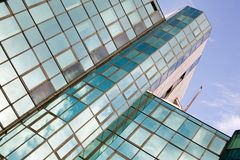 Business center. Business building, modern style, sky is reflected in the windows royalty free stock photography