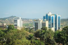 Business center of the city in the green trees. View from above. Kampala, Uganda - January 21, 2015: business center of the city in the green trees. View from royalty free stock photo