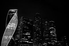 Business center with high skyscrapers. Business center in a large city with high skyscrapers in the eveningr Stock Photos