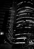 Business center with high skyscrapers. Business center in a large city with high skyscrapers in the eveningr Royalty Free Stock Photo