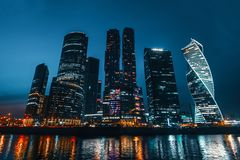 Business center Moscow City with modern futuristic skyscrapers buildings reflected in river in summer night Royalty Free Stock Image