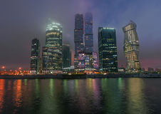 Business Center Moscow City at night in the fog. Stock Photo