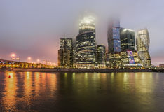Business Center Moscow City at night in the fog. Royalty Free Stock Photography