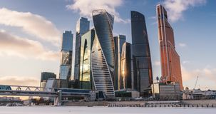 Business Center Moscow City Skyscrapers Time-lapse. Time-lapse with Business Center Moskva City in the winter, surrounded by a frozen river. Running through stock video footage