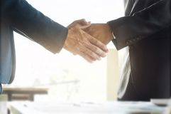 Business ceo hands shaking while meeting selected focus on hands.  royalty free stock photography