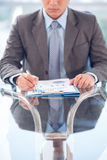 Business CEO. Vertical image of a business ceo analyzing business document at the office stock photos