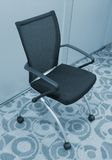 Business Chair. A contoured chair in a high-tech company Royalty Free Stock Photography
