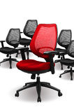 Business chair. A red chair and several black chairs stock image