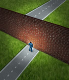 Business Challenge. And financial obstacles concept with a businessman standing in front of a large brick wall that has blocked his path and obstructed a Stock Images