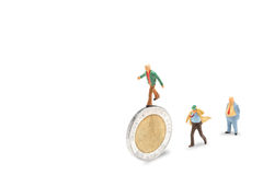 Business Challenge. Businessman on coins finance concept isolated on white with clipping path Royalty Free Stock Images