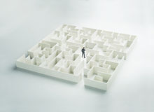 Business challenge. A businessman navigating through a maze. Rear view Stock Photography