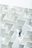 Business challenge. A businessman navigating through a maze. Top view Royalty Free Stock Photography